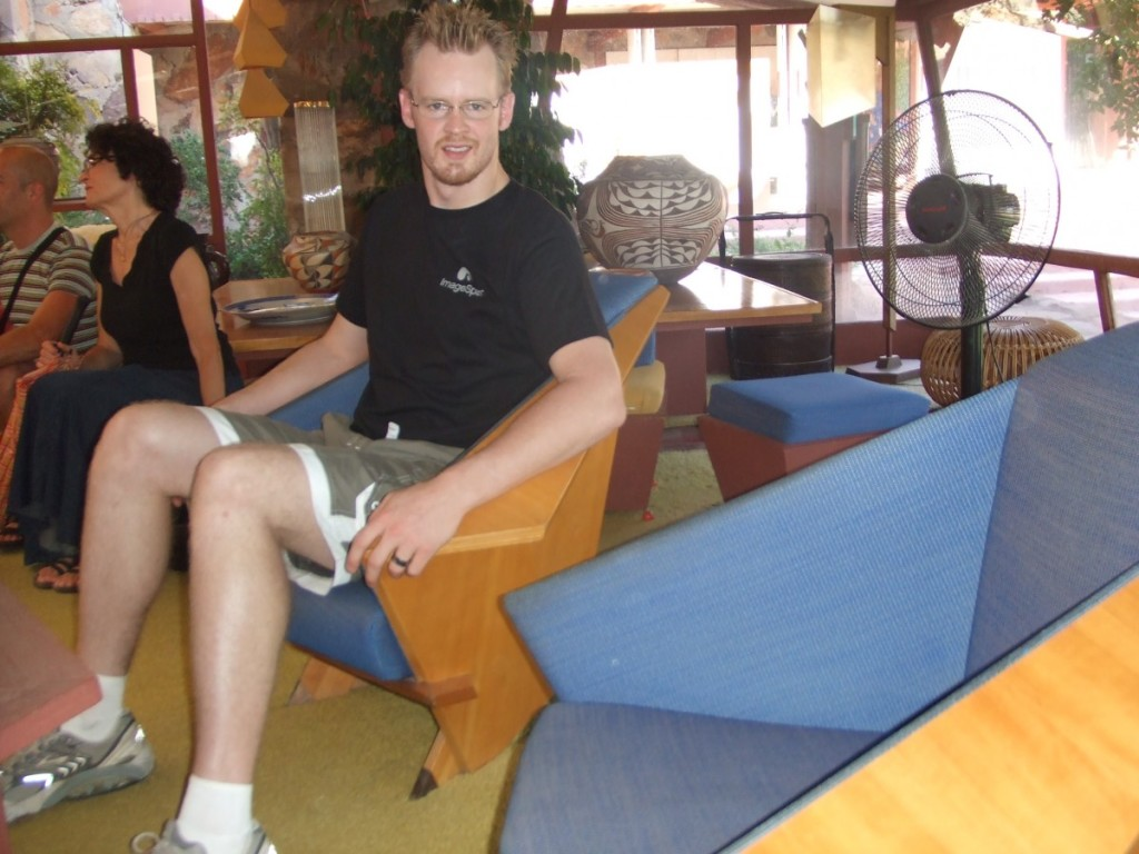 Derrick Perrin sits in Frank Lloyd Wright Origami Chair